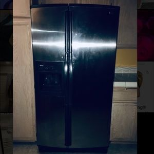 Kenmore refrigerator side by side.